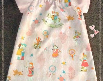 Girls cotton peasant style dress with flutter sleeves. Fabric pictures cowgirls,  Pocahontas girls,  dreamcatchers and cactus