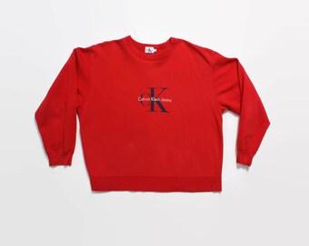 Vintage 90s Calvin Klein Sweatshirt / 1990s CK Red Spellout Logo Crewneck Pullover