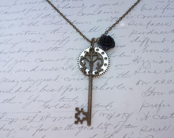 Skeleton key steampunk long necklace with black flower charm and gear