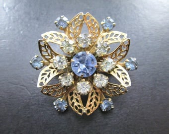 Vintage Gold Tn Rhinestone Star Brooch Pin with Blue & Clear Stones 60s