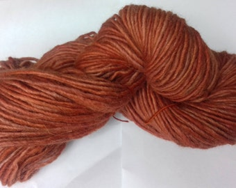 Brick. Approx 90g of aran yarn. 100% wool. Naturally dyed with madder.
