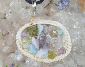 Handcrafted Reiki infused seashell necklace filled with amethyst, Citrine, peridot, topaz, larimar, kunzite, selenite, quartz and copper