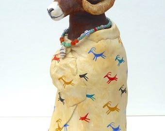 Bighorn ram sheep sculpture Native American Indian Plains buffalo robe Sioux Lakota southwestern petroglyph rock art turquoise shell beads