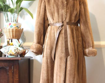 A full length faux fur coat, made by Astraka, from  Tissavel fabric. Size 12.