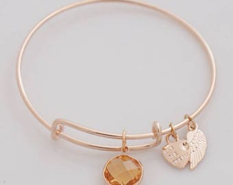 AA1213A ~ Gold Tone Wire Charm Bracelet with Faceted Amber Charm and a Small Heart and Angel Wing