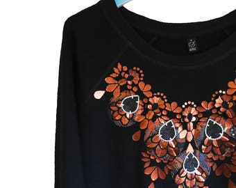 METALLIC COPPER hand embellished SWEATSHIRT. Black women's organic cotton, sweater, with a warm copper and patterned fabric design.