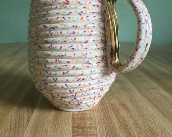 16oz Soft Pink Sprinkles mug with pearl rim and large 22k gold handle