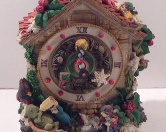 Christmas Ceramic Chalet Music Box with Clock Face and Hands, Holly Berries and Leaves, Tiny Mice and Elves all decked out for the Holidays