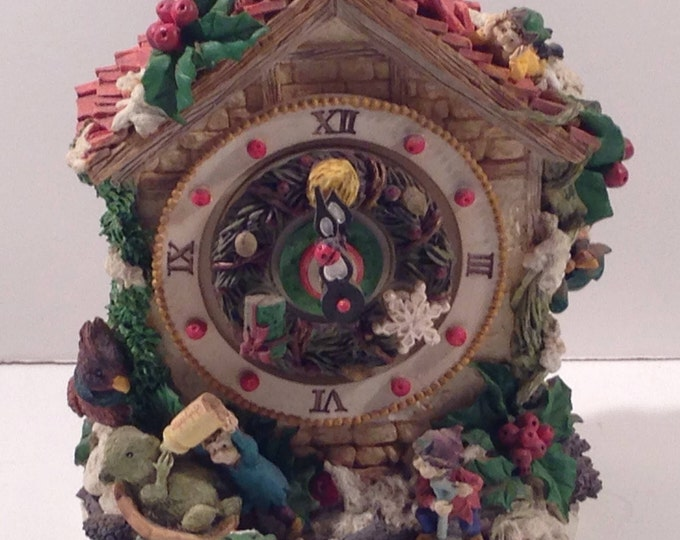 Chalet Music Box all decked out in Christmas cheer with a ceramc Garland Clock Face, Holly, Tiny Mice and Elves from Crafts by the Sea