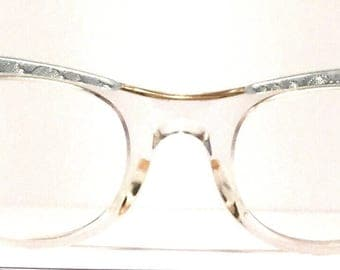 Vintage eyewear. Cat eye style. Made in USA by American Optical 1950's. Small petite size. Blue on clear. Excellent quality and condition!