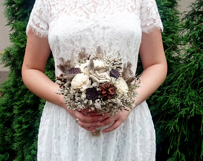 Bouquet with Cream Flowers, pine cones, natural guinea hen feathers and lotos