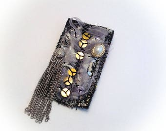 Brooch, art textile, black, white, gold, silver chain.