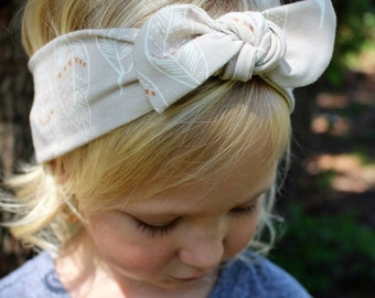 greige feather top knot headband