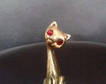 Red eyed Bronze cat figurine