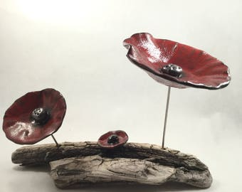 Flower ceramic red and black on Driftwood