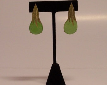 Gold leaf earrings and lime-coloured jade