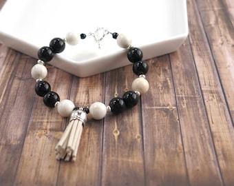 Black and beige beaded bracelet with tassel / black / beige / tassel / toggle / gift / lifestyle jewelry