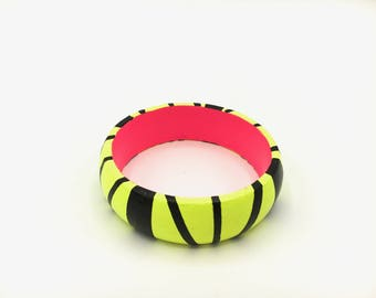 Handmade  bright geometric  wooden statement bangle in neon yellow, black and hot pink