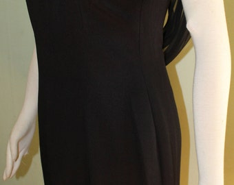 "Size Medium, Beautiful vintage little black dress, 1960's, 28"" waist"