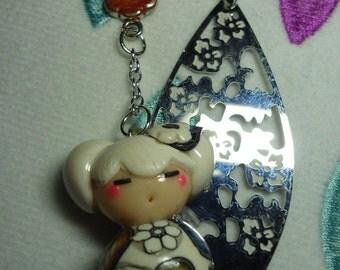 Brand page Kokeshi Cherry leaf filigree