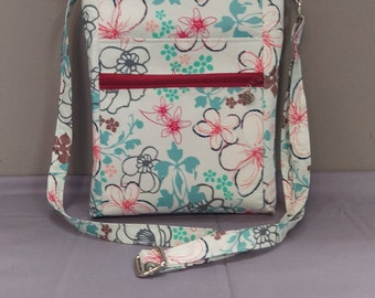 Pretty white floral fabric crossbody bag, shoulder bag. Room for all the essentials!