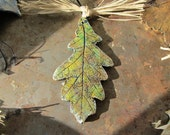 Ornament Decoration Real Oak Leaf Impression in Gold Green on Dark Blue Colors on Black Hemp Cord Raffia Bow