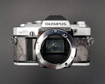 Olympus OM-30 SLR film camera - Silver Snakeskin