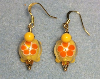 Yellow and tangerine lampwork turtle bead earrings adorned with tangerine Chinese crystal beads.