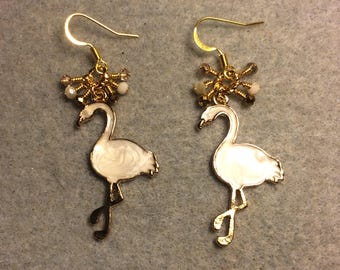 Off white enamel flamingo charm earrings adorned with tiny dangling white and gold Chinese crystal beads.