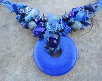 Necklace baroque lapis lazuli on blue silk cord