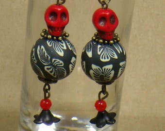Halloween earrings with red skulls and black flower