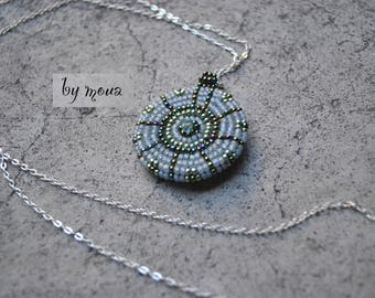 Necklace with beads woven round pendant on fine chain