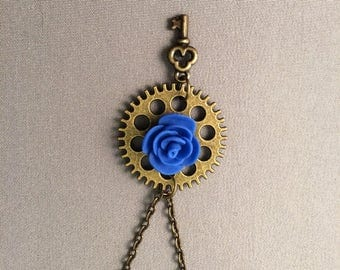 Blue rose in a steampunk gear with a key, blue rose, blue rose necklace, blue rose steampunk, rose necklace, beauty and the beast, key charm