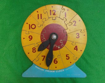 vintage wooden jigsaw clock 1950's