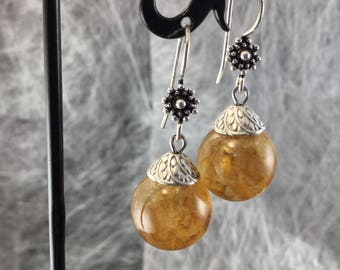 Earrings with resin bubbles and candy on 925 sterling silver hooks.