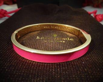 Vintage Kate Spade Hot Pink Cuff Bracelet with Goldtone Metal in the inside of the Bracelet comes in the Original Kate Spade Brown Gift Bag.