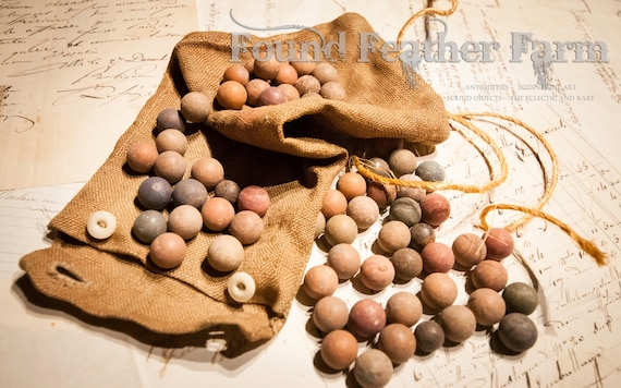Wonderful Collection of Antique French Clay Marbles in an Original Buttoned Hemp Pouch