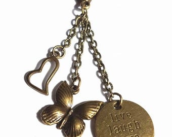 Bronze butterfly heart and live laugh love charm keychain/bag charm.