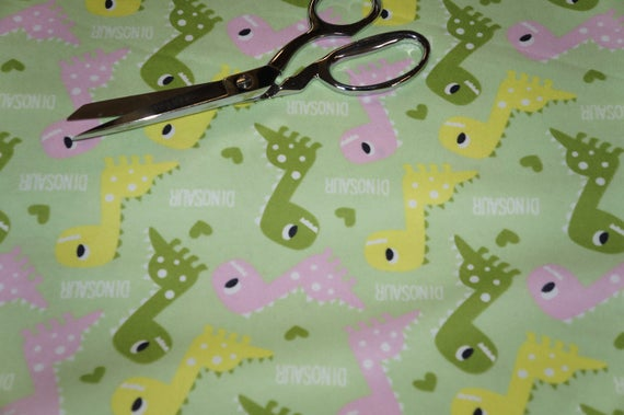 Dinosaur medley cotton flannel fabric by mook children for Children s flannel fabric by the yard