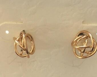 Dainty 14k goldfilled love knot post earrings.
