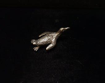 Original silicon bronze penguin sculpture by Daniel J. Riccio