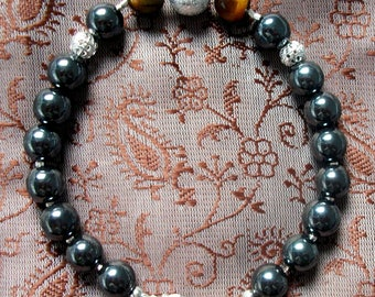 Hematite and Tiger eye (gemstones) bracelet. 925 silver plated
