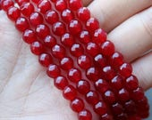red jade, 6mm beads, faceted beads, red beads, candy jade beads, gemstone beads, sold as 1 strand, approx.66 beads,