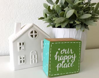 "wood sign: ""our happy place"""