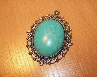 Pendant with cabochon turquoise 61X48mm