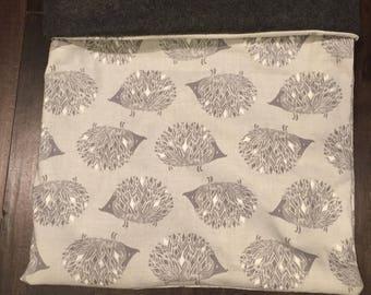 Grey hedgehog cuddle pouch