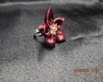 pretty Adjustable ring with a Burgundy satin flower