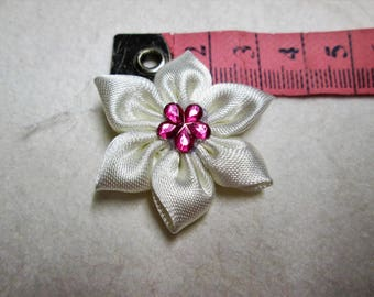 Ivory satin with a flower is adorned with a tassel pink Center