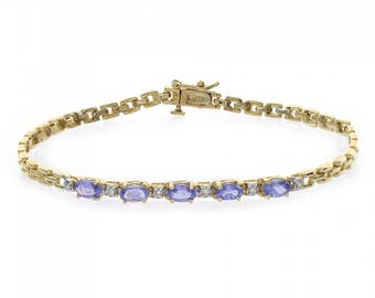1.06 Carat Oval Cut Tanzanite & Round Cut Diamond Bracelet 14K Yellow Gold