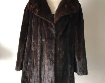 Brown mink fur coat , woman size medium .